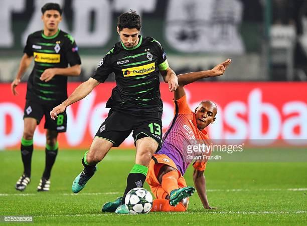 Fernandinho of Manchester City challenges Lars Stindl of Borussia Moenchengladbach during the UEFA Champions League match between VfL Borussia...