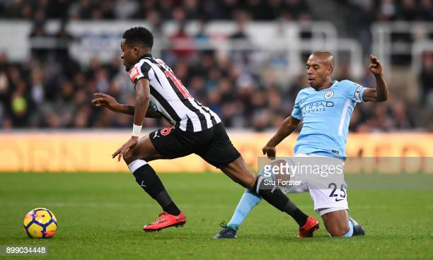Fernandinho of Manchester City challenges Rolando Aarons of Newcastle United during the Premier League match between Newcastle United and Manchester...