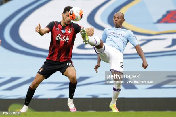 Fernandinho of Manchester City clears from Dominic Solanke of Bournemouth during the Premier League match between Manchester City and AFC Bournemouth...