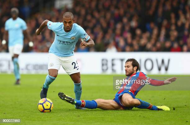 Fernandinho of Manchester City evades Yohan Cabaye of Crystal Palace during the Premier League match between Crystal Palace and Manchester City at...