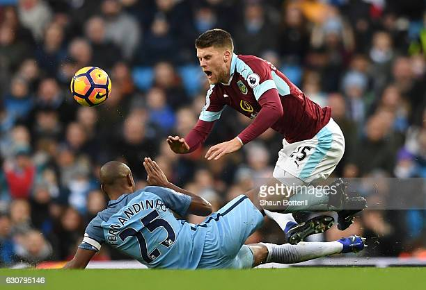 Fernandinho of Manchester City fouls Johann Gudmundsson of Burnley leading to his red card during the Premier League match between Manchester City...