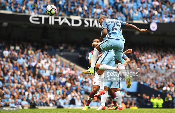 Fernandinho of Manchester City heads his team's second goal during the Premier League match between Manchester City and West Ham United at Etihad...