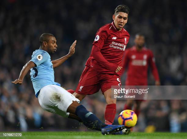 Fernandinho of Manchester City is challenged by Roberto Firmino of Liverpool during the Premier League match between Manchester City and Liverpool FC...