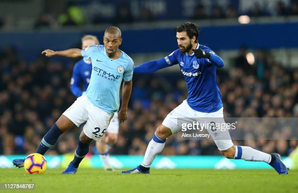 Fernandinho of Manchester City is closed down by Andre Gomes of Everton during the Premier League match between Everton FC and Manchester City at...