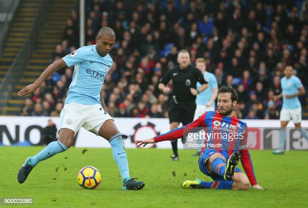 Fernandinho of Manchester City is faced by Yohan Cabaye of Crystal Palace during the Premier League match between Crystal Palace and Manchester City...