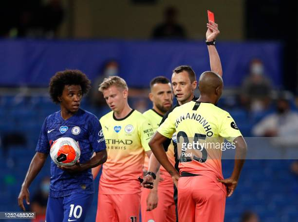 Fernandinho of Manchester City is shown a red card by Stuart Attwell during the Premier League match between Chelsea FC and Manchester City at...