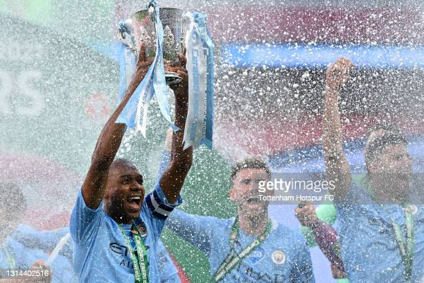 Fernandinho of Manchester City lifts the Carabao Cup Trophy as his team celebrate victory after the Carabao Cup Final between Manchester City and...