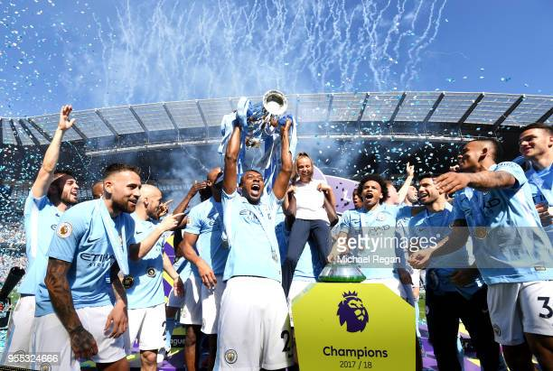 Fernandinho of Manchester City lifts The Premier League Trophy after the Premier League match between Manchester City and Huddersfield Town at Etihad...