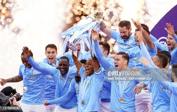 Fernandinho of Manchester City lifts the Premier League Trophy, as Manchester City are presented with the Trophy as they win the league following the...