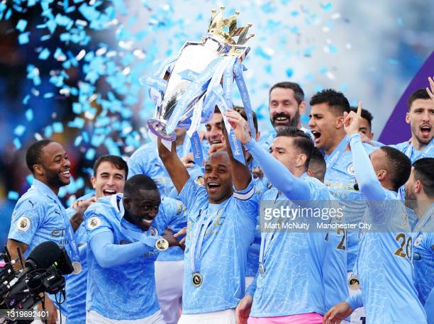Fernandinho of Manchester City lifts the Premier League trophy during the Premier League match between Manchester City and Everton at Etihad Stadium...