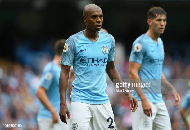 Fernandinho of Manchester City looks on during the Premier League match between Manchester City and Huddersfield Town at Etihad Stadium on August 19...