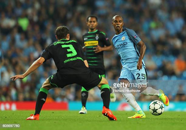 Fernandinho of Manchester City plays the ball past Andreas Christensen of Borussia Moenchengladbach during the UEFA Champions League match between...