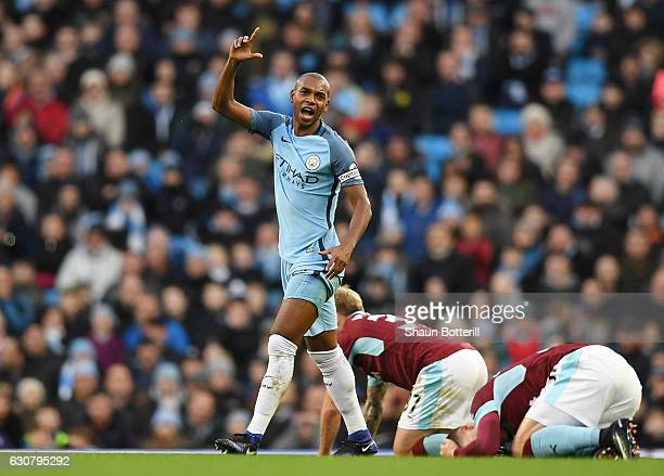 Fernandinho of Manchester City reacts after his challenge on Johann Gudmundsson of Burnley leading to his red card during the Premier League match...