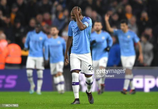 Fernandinho of Manchester City reacts after Raheem Sterling of Manchester CIty scores his sides first goal during the Premier League match between...