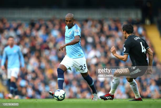 Fernandinho of Manchester City runs with the ball during the Premier League match between Manchester City and Burnley FC at Etihad Stadium on October...