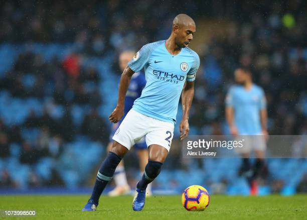 Fernandinho of Manchester City runs with the ball during the Premier League match between Manchester City and Everton FC at Etihad Stadium on...