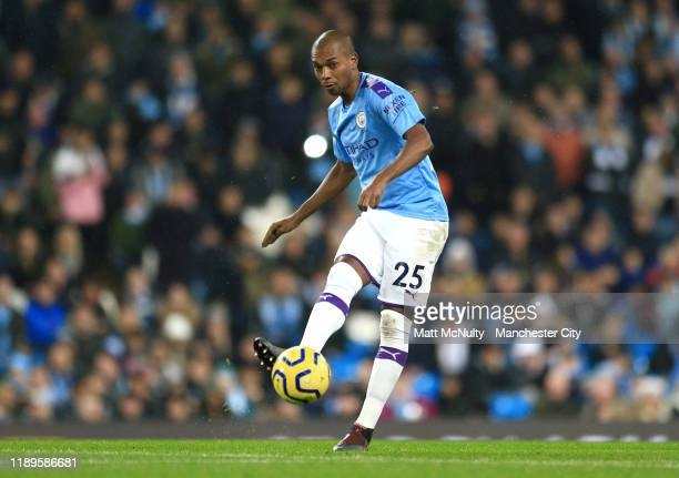 Fernandinho of Manchester City runs with the ball during the Premier League match between Manchester City and Chelsea FC at Etihad Stadium on...