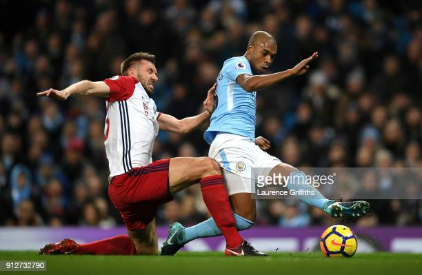 Fernandinho of Manchester City scores his sides first goal during the Premier League match between Manchester City and West Bromwich Albion at Etihad...