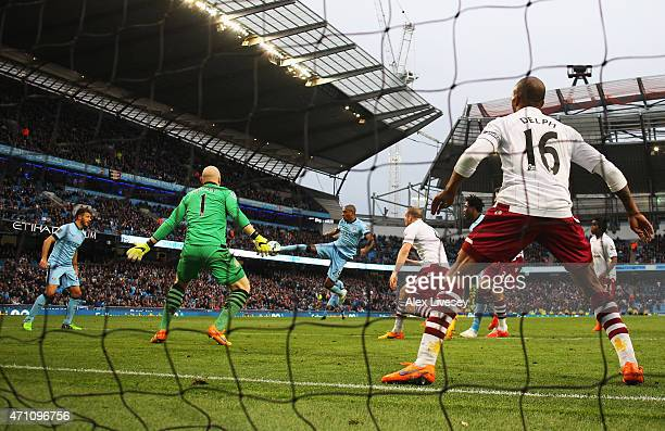 Fernandinho of Manchester City scores his team's third goal past Brad Guzan of Aston Villa during the Barclays Premier League match between...