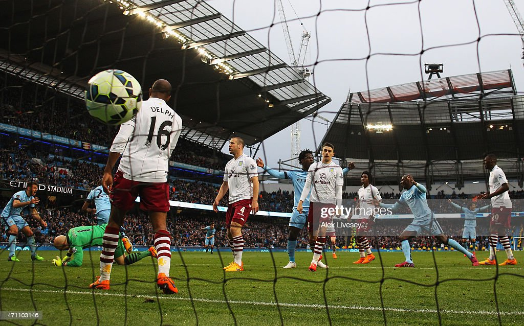 Fernandinho of Manchester City scores his team's third goal past Brad Guzan of Aston Villa during the Barclays Premier League match between Manchester City and Aston Villa at Etihad Stadium on April 25, 2015 in Manchester, England.