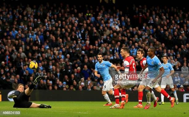 Fernandinho of Manchester City scores their fifth goal past Wojciech Szczesny of Arsenal during the Barclays Premier League match between Manchester...