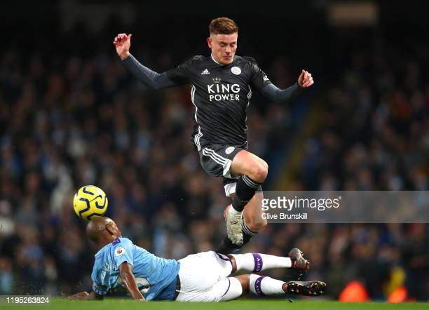 Fernandinho of Manchester City tackles Harvey Barnes of Leicester City during the Premier League match between Manchester City and Leicester City at...