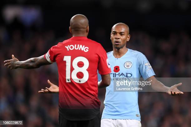 Fernandinho of Manchester City talks with Ashley Young of Manchester United during the Premier League match between Manchester City and Manchester...