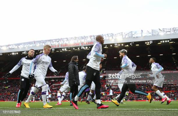 Fernandinho of Manchester City warms up with teammates during the Premier League match between Manchester United and Manchester City at Old Trafford...