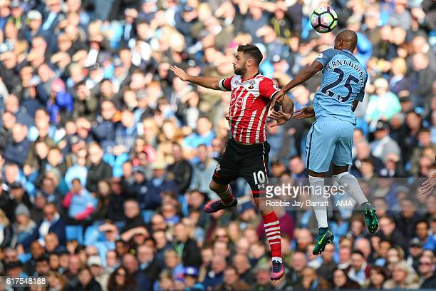 Fernandinho of Manchester City wins a header against Charlie Austin of Southampton during the Premier League match between Manchester City and...