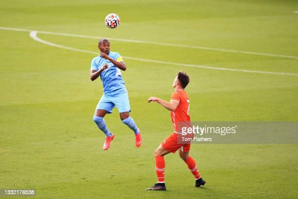 Fernandinho of Manchester City wins a header during the pre-season friendly match between Manchester City and Blackpool at Manchester City Football...