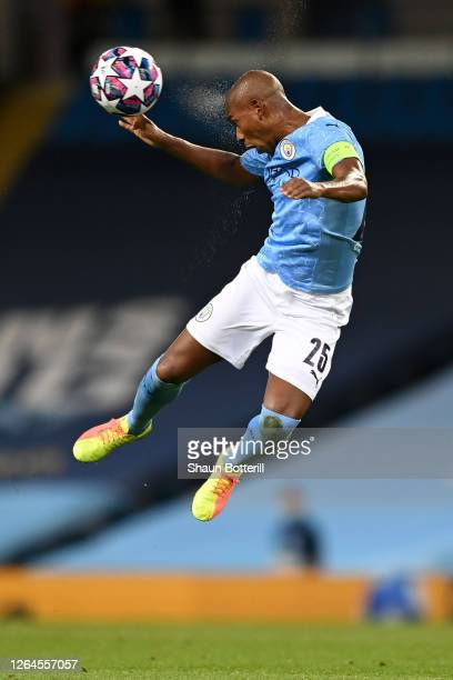 Fernandinho of Manchester City wins a header during the UEFA Champions League round of 16 second leg match between Manchester City and Real Madrid at...