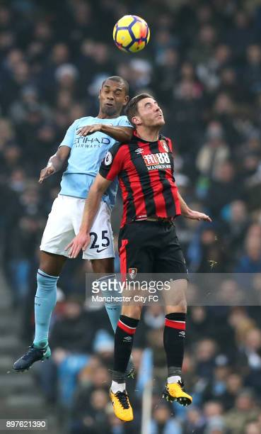 Fernandinho of Manchester City wins a header over Dan Gosling of AFC Bournemouth during the Premier League match between Manchester City and AFC...