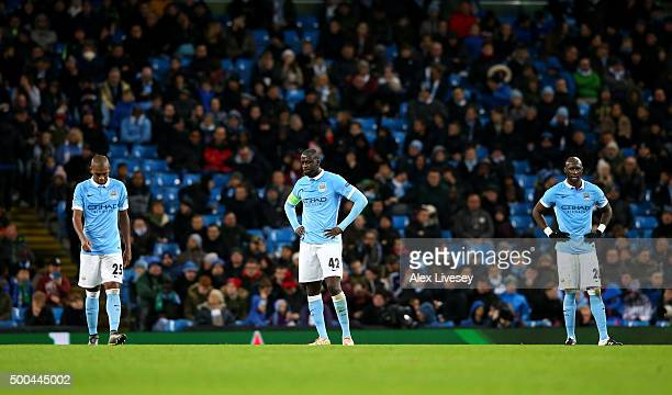 Fernandinho Yaya Toure and Eliaquim Mangala of Manchester City stand dejected after conceding a second goal during the UEFA Champions League Group D...