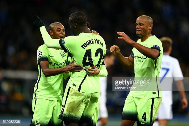 Fernandinho Yaya Toure and Vincent Kompany of Manchester City celebrate their team's 31 victory as the final whistle blows during the UEFA Champions...