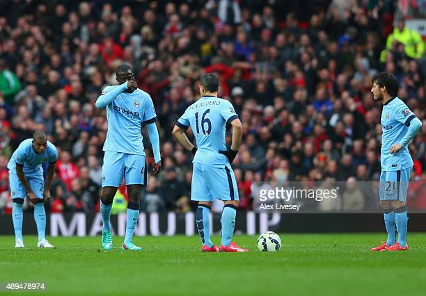 Fernandinho Yaya Toure Sergio Aguero and David Silva of Manchester City look dejected during the Barclays Premier League match between Manchester...