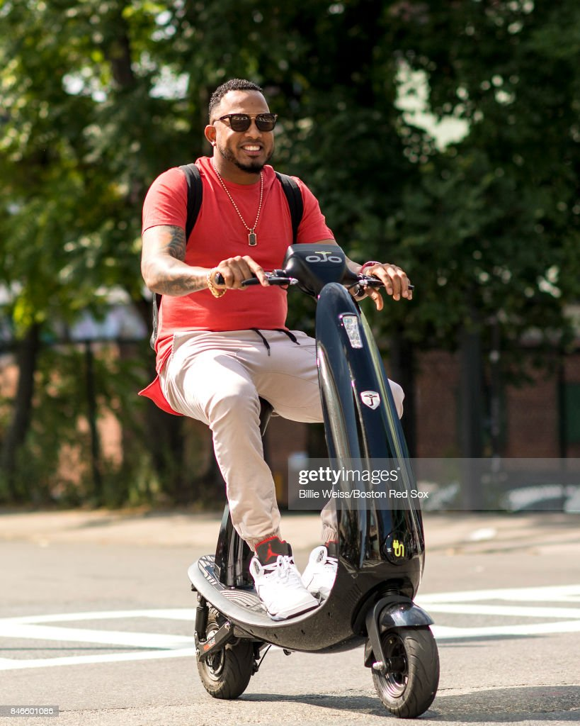 Fernando Abad #58 of the Boston Red Sox arrives to the ballpark on a scooter before a game against the Oakland Athletics on September 13, 2017 at Fenway Park in Boston, Massachusetts.