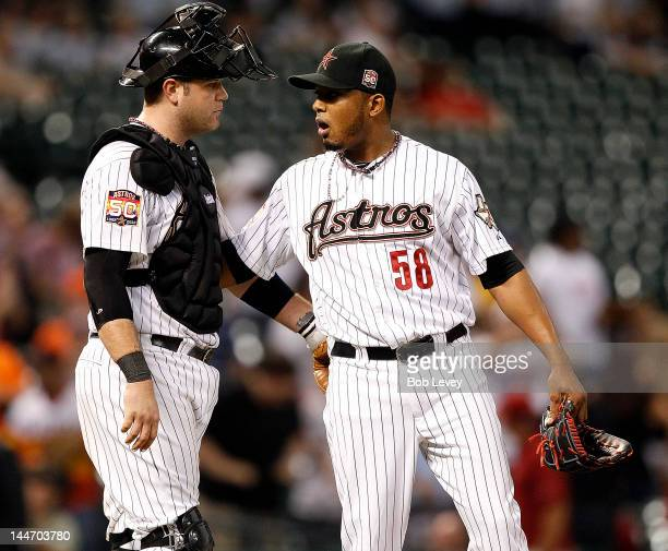 Fernando Abad of the Houston Astros and catcher Chris Snyder celebrate the win over the Milwaukee Brewers at Minute Maid Park on May 17 2012 in...
