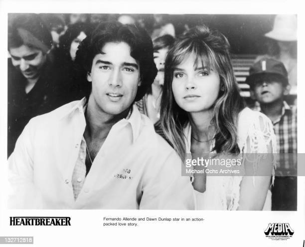 Fernando Allende and Dawn Dunlap sitting together in a scene from the film 'Heartbreaker' 1983