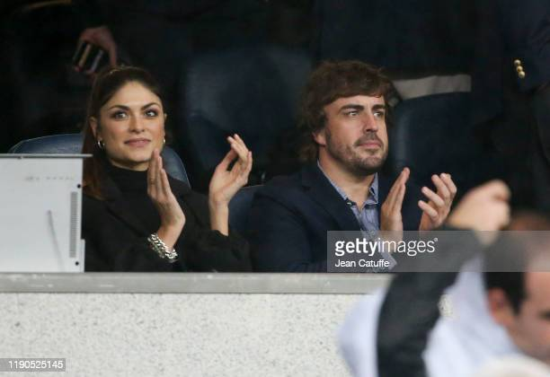 Fernando Alonso and girlfriend Linda Morselli attend the UEFA Champions League group A match between Real Madrid and Paris SaintGermain at Santiago...