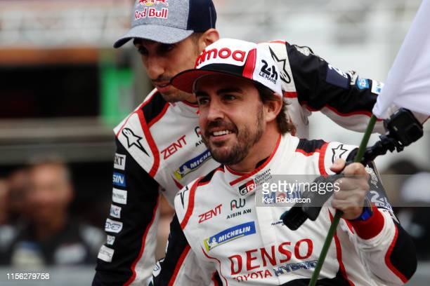 Fernando Alonso celebrates as he and co-drivers Kazuki Nakajima and Sebastien Buemi take the flag in their Toyota Gazoo Racing TS050 Hybrid to secure...