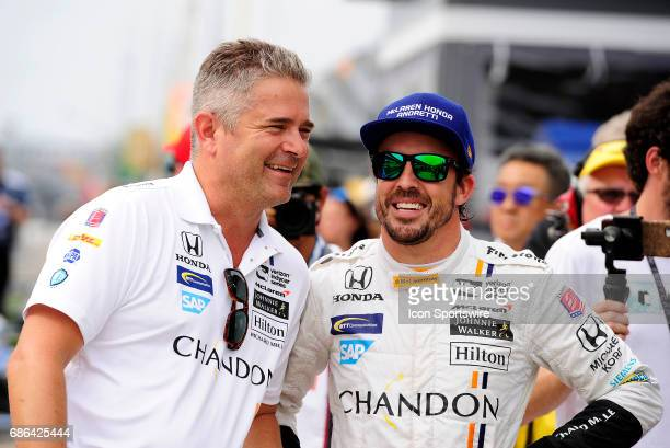 Fernando Alonso driver of the McLarenHondaAndretti Honda debriefs with his crew after the qualifying session for the Indianapolis 500 on May 20 at...