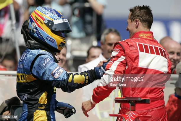 Fernando Alonso left congratulates Michael Schumacher of Team Ferrari after the Formula 1 GP in Magny Cours France Sunday July 16 2006 Ferrari's...