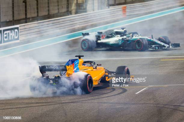 Fernando Alonso of McLaren and Spain and Lewis Hamilton of Mercedes and Great Britain during the Abu Dhabi Formula One Grand Prix at Yas Marina...