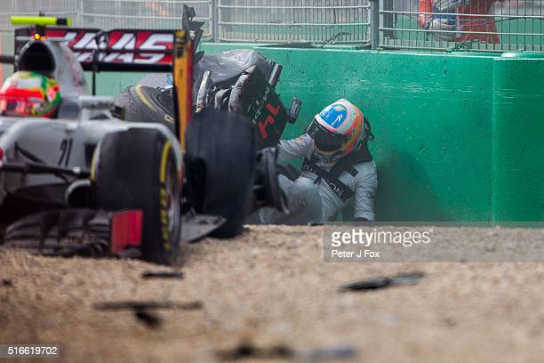 Fernando Alonso of McLaren and Spain climbs out of his car after crashing out of the Australian Formula One Grand Prix at Albert Park on March 20...