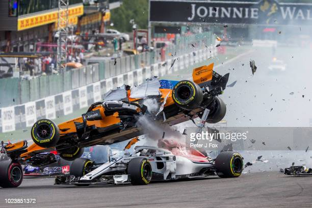 Fernando Alonso of McLaren and Spain crashes into Charles Leclerc of Alfa Romeo Sauber and France during the Formula One Grand Prix of Belgium at...