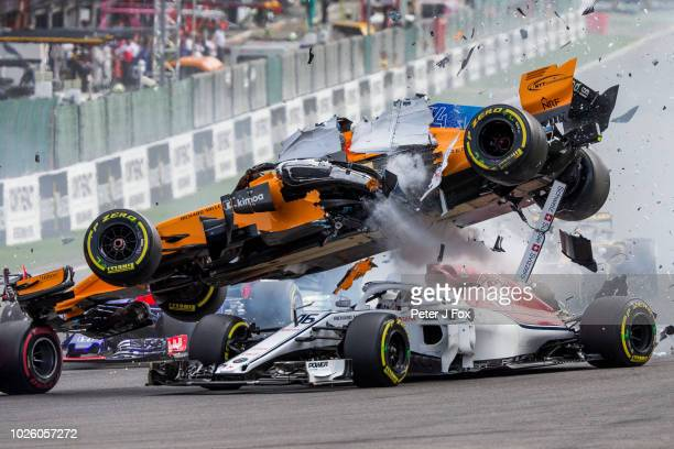 Fernando Alonso of McLaren and Spain crashes over the top of Charles Leclerc of Alfa Romeo Sauber and France during the Formula One Grand Prix of...