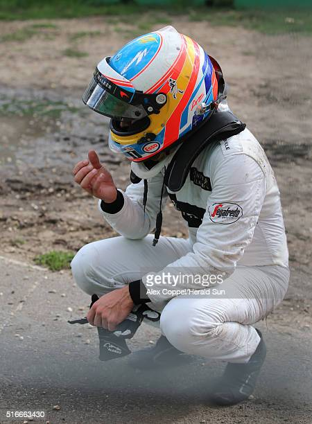 Fernando Alonso of McLaren and Spain reacts after crashing heavily during the Australian Formula One Grand Prix at Albert Park on March 20 2016 in...