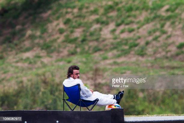 Fernando Alonso of McLaren and Spain sits on a deckchair after suffering car breakdown during final qualifying for the Formula One Grand Prix of...