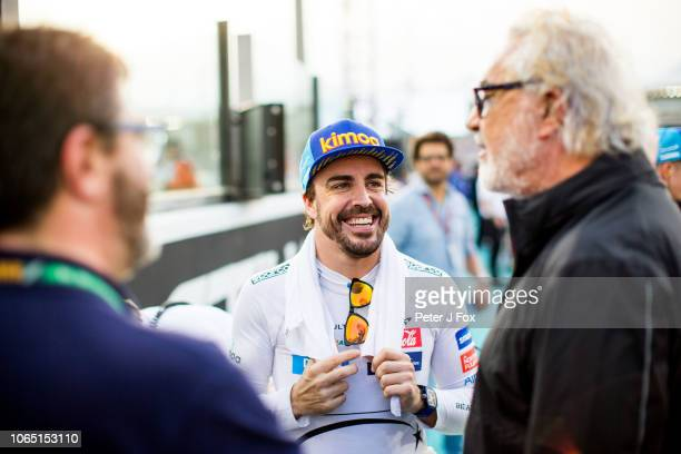 Fernando Alonso of McLaren and Spain with Flavio Briatore of Italy during the Abu Dhabi Formula One Grand Prix at Yas Marina Circuit on November 25,...