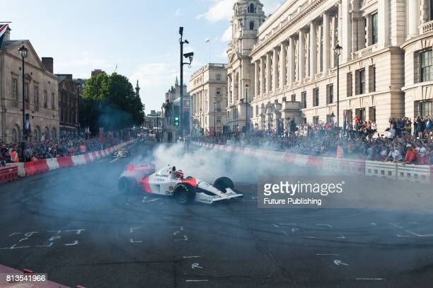 Fernando Alonso of McLaren drives along Whitehall during F1 Live London All 10 Formula 1 teams came together for the first time in history outside of...